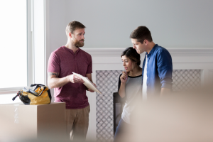A contractor gives an initial consultation to homeowners